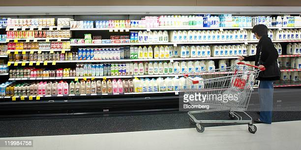 A shopper browses products in the milk section at a Wesfarmers Ltd Coles supermarket in Sydney Australia on Thursday July 28 2011 Wesfarmers Ltd...