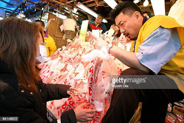 A shopper buys a king crab at a fish stall in the Ameya Yokocho street market on December 31 2008 in Tokyo Japan People shop around in preparation to...
