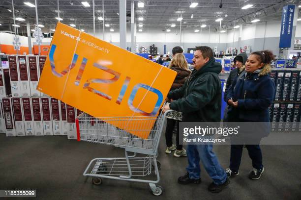 A shopper buys a TV at a Best Buy Inc store on November 28 2019 in Chicago Illinois Known as 'Black Friday' the day after Thanksgiving marks the...