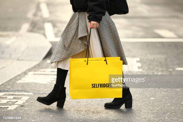 Shopper carries a bag from department store Selfridges along Regent Street in London, England, on December 5, 2020. London has returned to so-called...