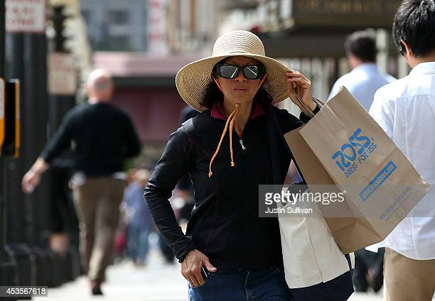 Shopper carries a bag from Ross Dress For Less on August 13, 2014 in San Francisco, California. According to a Commerce Department report, July...