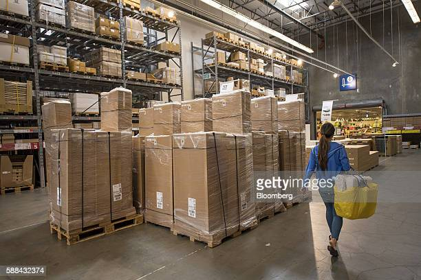 A shopper carries a bag inside an IKEA AB store in Emeryville California US on Tuesday Aug 9 2016 The US Census Bureau is scheduled to release...