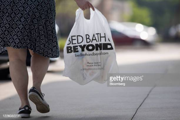 Shopper carries a bag outside a Bed Bath & Beyond store in Farmington Hills, Michigan, U.S., on Friday, July 10, 2020. Bed Bath & Beyond Inc.Plans...