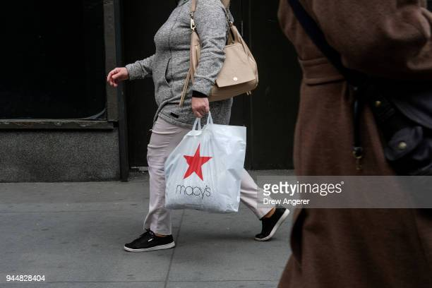 A shopper carries a Macy's bag in the Herald Square neighborhood of Manhattan April 11 2018 in New York City US consumer prices rose 24 percent in...