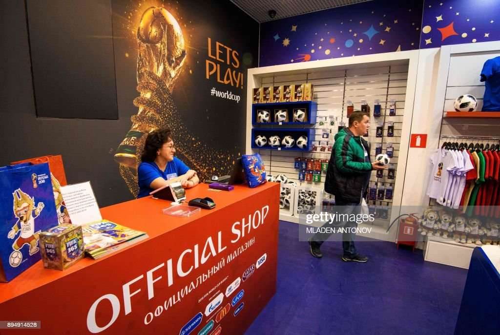 A shopper carries a replica of the official football at the first official FIFA World Cup 2018 merchandise store which opened recently at the Central Childrens Store in Moscow on December 18, 2017. PHOTO / Mladen ANTONOV