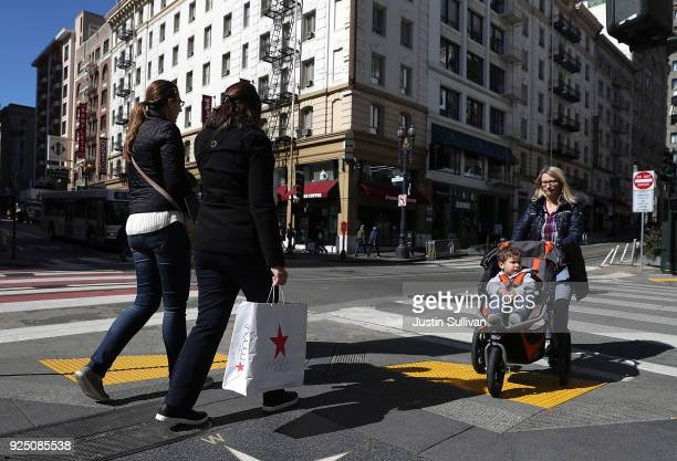 Shopper carries a shopping bag while walking in the Union Square district on February 27, 2018 in San Francisco, California. The U.S. Consumer...