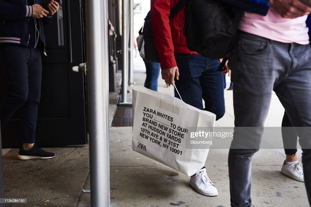 b0aaf8ad A shopper carries a Zara, operated by Inditex SA, retail bag in the ...