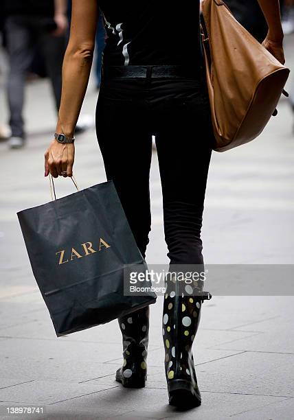 A shopper carries a Zara shopping bag at a Westfield Group shopping mall in Sydney Australia on Tuesday Feb 14 2012 Westfield Group said it had...