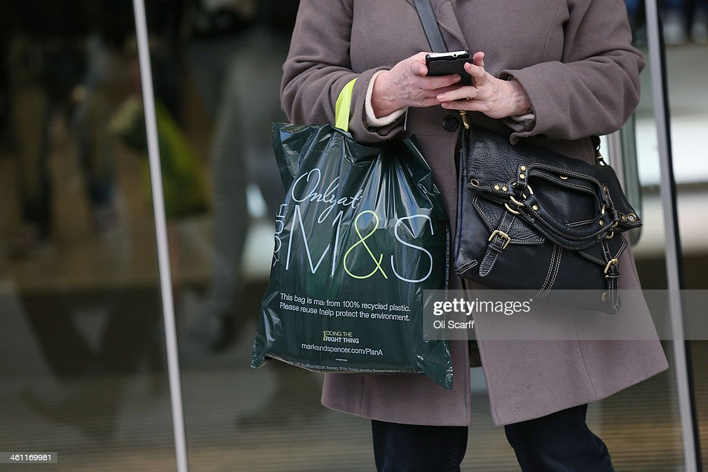 A shopper carries an M&S bag out of a branch of Marks & Spencer on January 7, 2014 in London, England. The food and clothing retailer, which has traded for 130 years, has seen a recent drop in share price as investors are predicting disappointing sales figures for the store's clothing division.