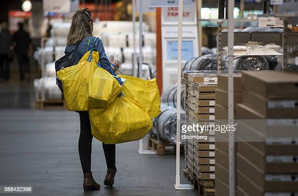 A shopper carries bags inside an IKEA AB store in Emeryville California US on Tuesday Aug 9 2016 The US Census Bureau is scheduled to release...
