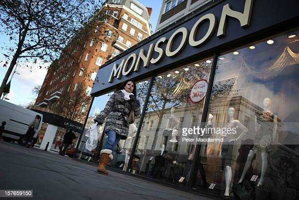 A shopper carries bags on the King's Road in Chelsea on December 5 2012 in London England The Chancellor of the Exchequer George Osborne has stated...