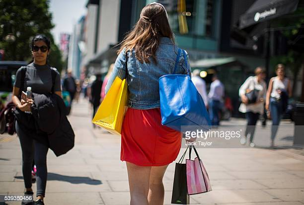 A shopper carries her bags along Oxford Street on June 9 2016 in London England Conditions are tough for the High Street as retailers recorded a 19%...