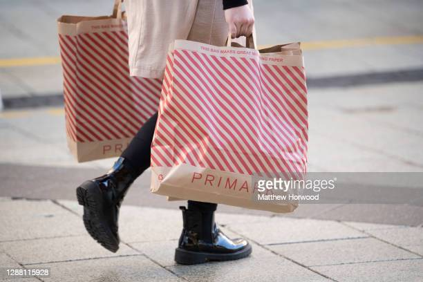 Shopper carries Primark bags on Black Friday on November 27, 2020 in Cardiff, Wales. Restrictions across Wales have been relaxed following a two-week...