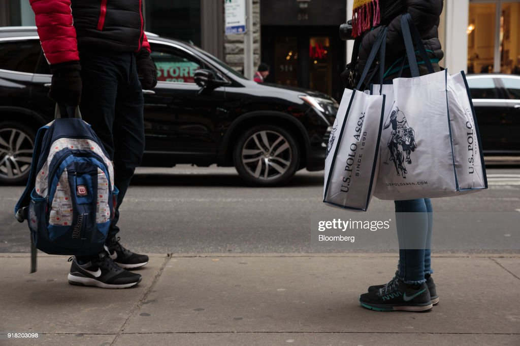 A shopper carries Ralph Lauren Corp. retail bags in the SoHo neighborhood of New York, U.S., on Friday, Feb. 9, 2018. Bloomberg is scheduled to release consumer comfort figures on February 15. Photographer: Sarah Blesener/Bloomberg via Getty Images