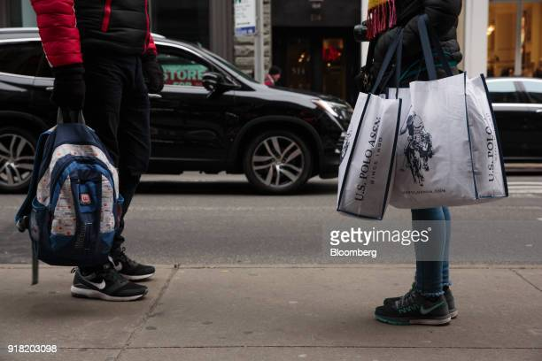 A shopper carries Ralph Lauren Corp retail bags in the SoHo neighborhood of New York US on Friday Feb 9 2018 Bloomberg is scheduled to release...