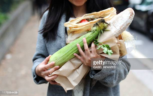 A shopper carries vegetables and bread bought at The Spread farmers' market in Primrose Hill north west London on October 5 2019 Brexit supporters...