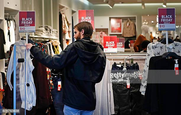 A shopper checks out clothing at the HM store at the City Creek Center looking for 'Black Friday' deals on November 25 2016 in Salt Lake City Utah...