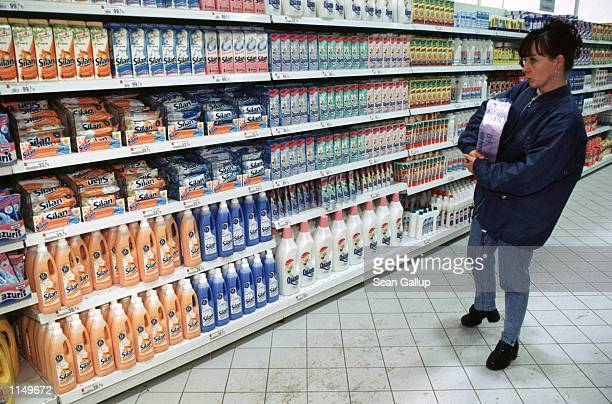 A shopper checks out fabric softeners at Hypernova one of the numerous enormous discount retailers that have sprung up around Prague Czech Republic...