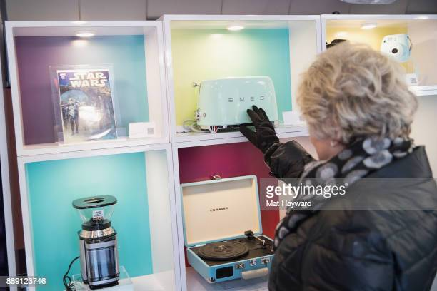 A shopper checks out merchandise during the 'Did You Check eBay' Holiday Airstream tour at Westlake Center Plaza on December 9 2017 in Seattle...
