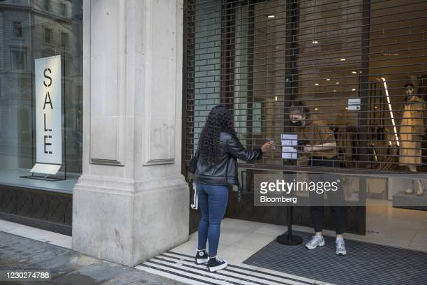 Shopper collects a click and collect order at a Zara clothing store, operated by Inditex SA, on Regent Street in London, U.K., on Wednesday, Dec. 23,...