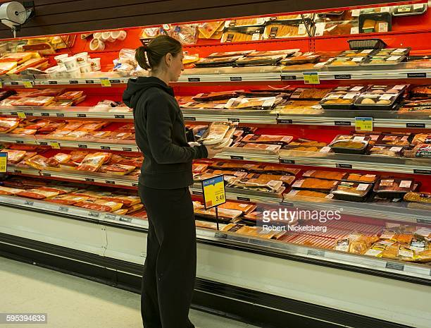 A shopper compares packaged cuts of chicken in the meat section at a Price Chopperbrand supermarket South Burlington Vermont November 1 2015