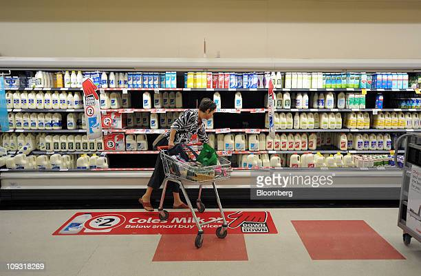 Shopper Dianna Falini selects a bottle of milk from the dairy section of a Coles Group Ltd supermarket in Melbourne Australia on Friday Feb 18 2011...