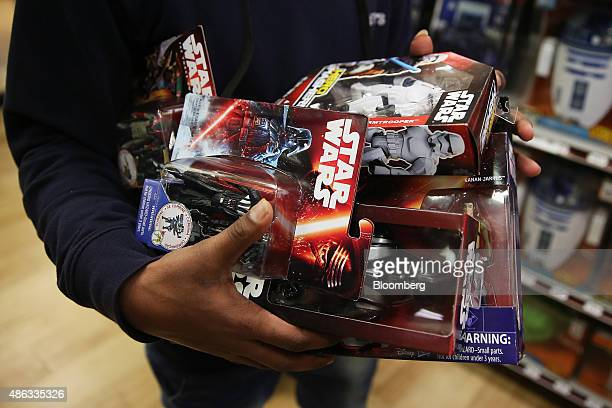 A shopper displays Walt Disney Co Star Wars movie franchise merchandise at a Target Australia Pty department store in the suburb of Parramatta in...