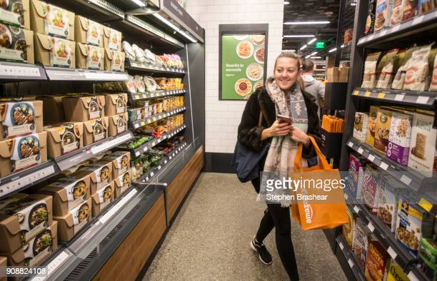 Shopper Ela Ustel walks through the Amazon Go store on January 22 2018 in Seattle Washington After more than a year in beta Amazon opened the...