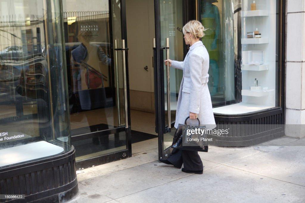 Shopper entering Barney's : Stock Photo