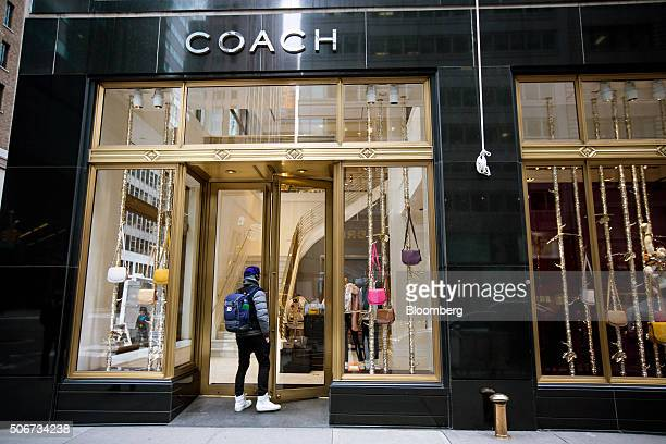 A shopper enters a Coach Inc store in New York US on Thursday Jan 22 2015 Coach Inc is expected to release earnings figures on January 26...