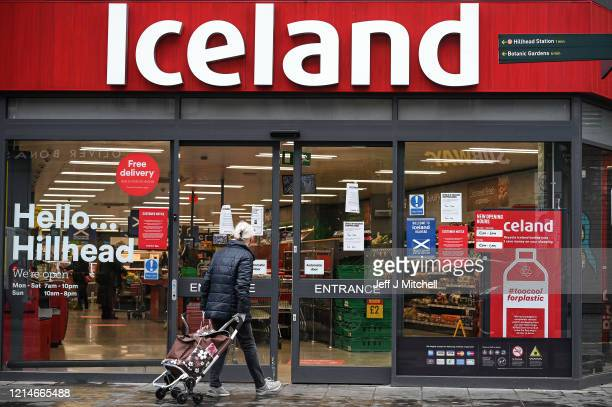 A shopper enters a Iceland shop on Byres Road to allow older shoppers to buy food when it is quieter amid the coronavirus outbreak on March 25 2020...