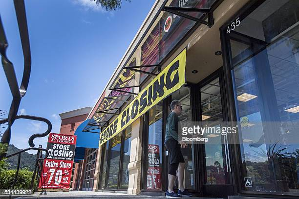 A shopper enters a Sports Authority Inc store in Corte Madera California US on Tuesday May 24 2016 A judge overseeing the chain's bankruptcy approved...