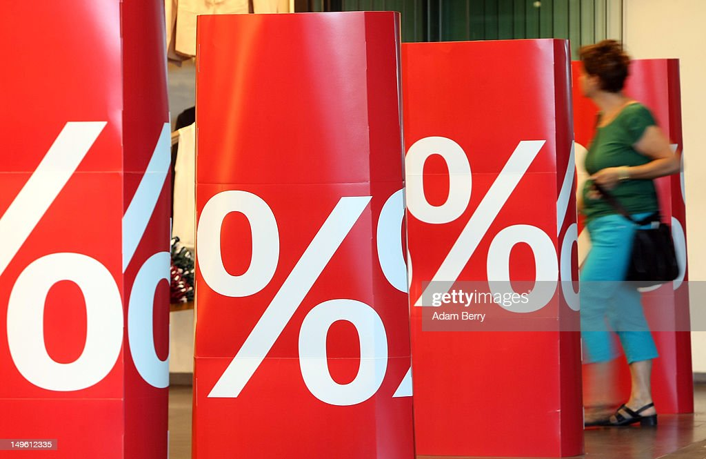 A shopper enters a store advertising summer sales on August 1, 2012 in Berlin, Germany. German retailers began their annual summer clearance sale on Monday, offering deep discounts of up to 80 percent on warm weather items as they prepare to stock up for the autumn shopping season.