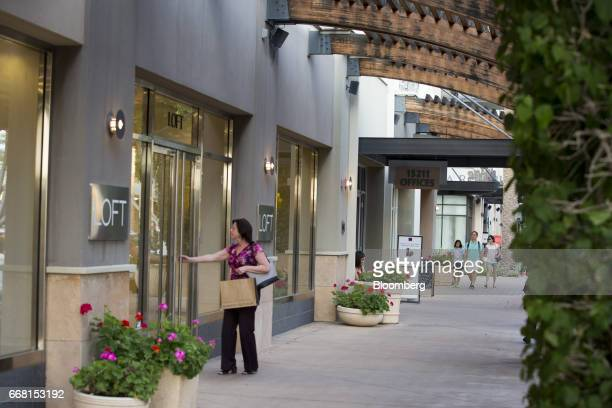 A shopper enters an Ann Taylor Inc Loft store at the Scottsdale Quarter shopping mall in Scottsdale Arizona US on Tuesday April 11 2017 The US Census...