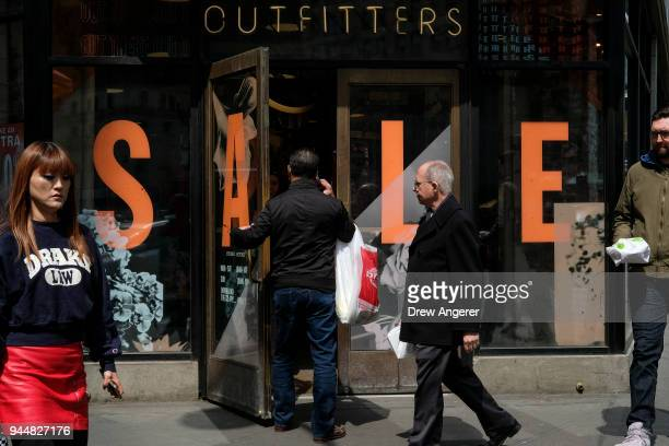 A shopper enters an Urban Outfitters store in the Herald Square neighborhood of Manhattan April 11 2018 in New York City US consumer prices rose 24...