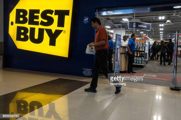 A shopper exits a Best Buy Co store at the Forum Buenavista mall in Mexico City Mexico on Monday Nov 20 2017 The National Institute of Statistics and...