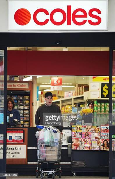 A shopper exits a Coles Group Ltd supermarket in Sydney Australia on Wednesday Aug 22 2007 Wesfarmers Ltd Australia's secondlargest retailer will...