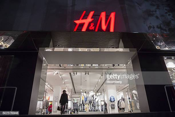 A shopper exits a Hennes Mauritz AB store in Shanghai China on Monday Dec 21 2015 China will add monetary stimulus next year making good on a pledge...
