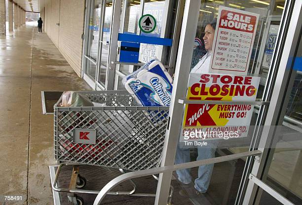 A shopper exits a Kmart store March 25 2002 that is scheduled for closing in Arlington Heights IL US bankruptcy Judge Susan Pierson Sonderby has...