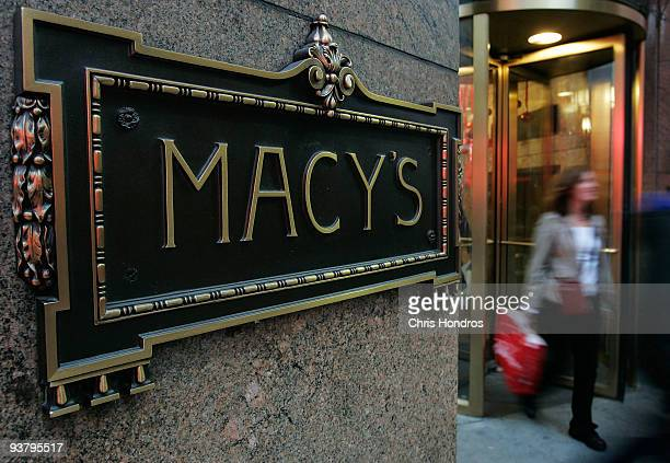 A shopper exits Macy's department store December 3 2009 in New York City Retail sales declined 03 percent with Macy's dopping 61 percent in November...