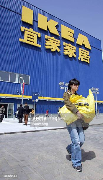 A shopper exits the Ikea store in Beijing China Wednesday April 12 2006 China's retail sales rose at the fastest pace in more than a year in April as...