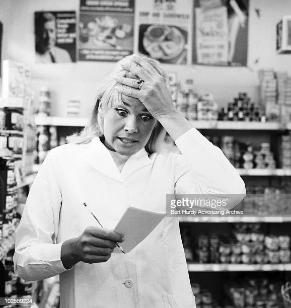 A shopper experiences an unpleasant moment of realisation at a supermarket in Bethnal Green London 15th November 1967