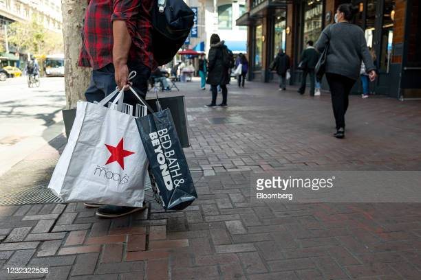 Shopper holds Macy's Inc. And Bed Bath & Beyond Inc. Branded shopping bags in San Francisco, California, U.S., on Wednesday, April 14, 2021. U.S....