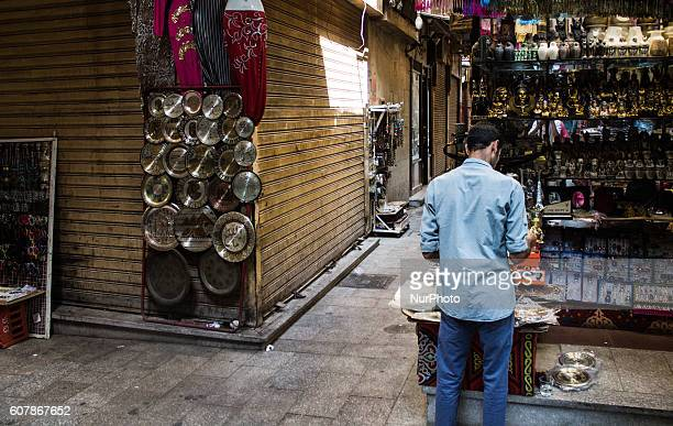 Shopper in Khan AlKhalili market in Cairo Egypton September 19 2016 The Khan elKhalili is a major souk in the Islamic district of Cairo Egypt The...