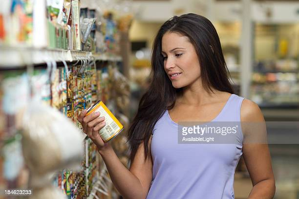 Shopper in Store Reads Label Horizontal