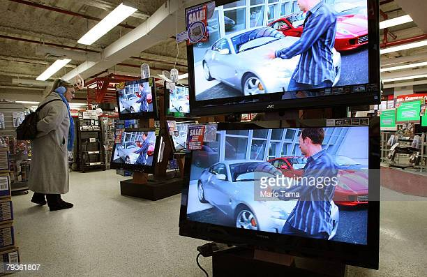 A shopper inspects flat panel televisions in a PC Richard Son store January 29 2008 in New York City The Commerce Department announced that orders...
