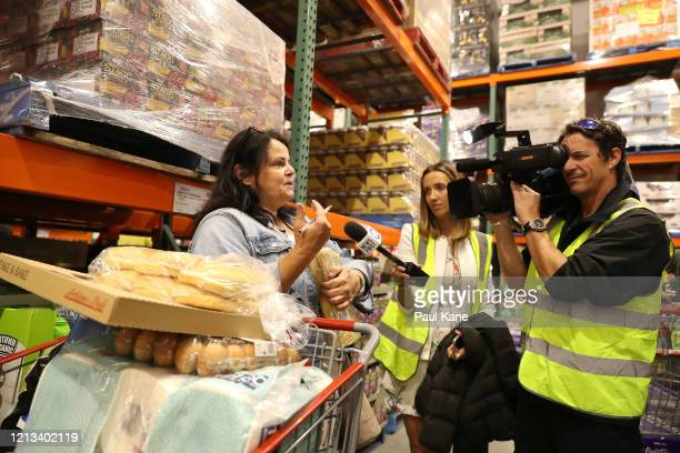 A shopper is interviewed by a television news crew at Costco Perth on March 19 2020 in Perth Australia The store which is the first Costco in Western...