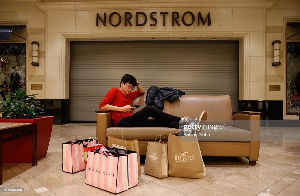 Shopper Joshua Kim Sits With His Packages As He Waits For Nordstrom News Photo Getty Images