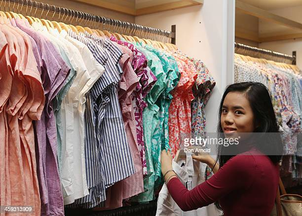 Shopper Julie Tran checks out the Boxing Day sales at David Jones in its city store on December 26 2013 in Sydney Australia Boxing Day is one of the...