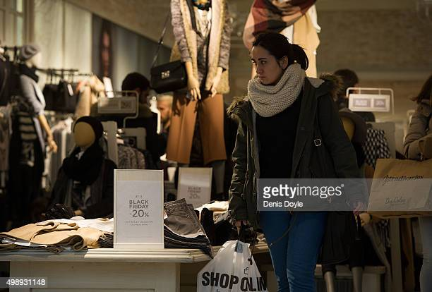 A shopper leaves a retial store advertising 'Black Friday' discounts on November 27 2015 in Madrid Spain Originating in the USA as a sales day...